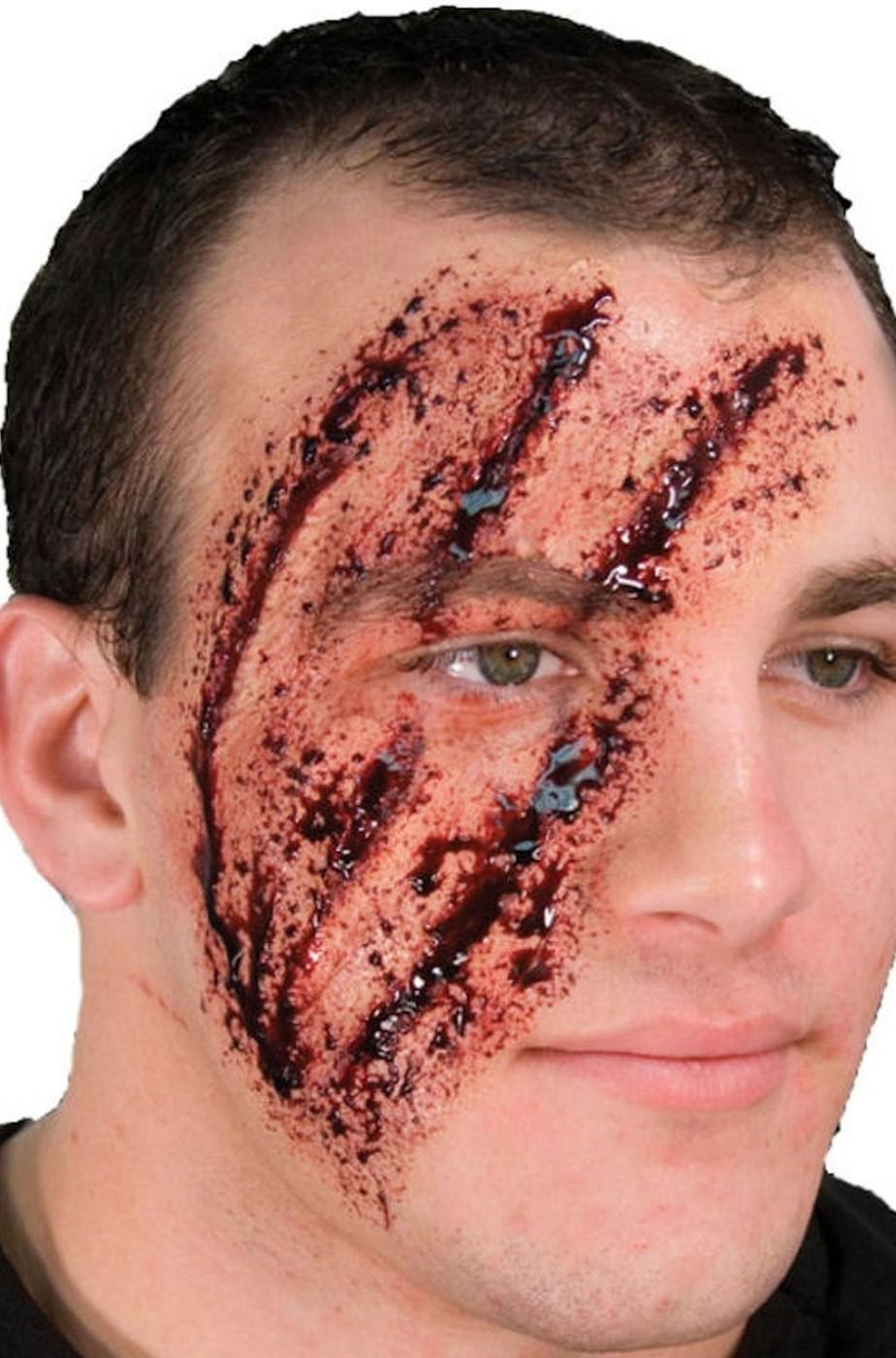 Trucco Halloween protesi ferite in lattice graffi di artiglio sul viso 6d41fa0a6980