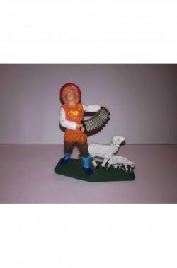 Figurina Presepe in plastica (cm 7 o 10 s.q.) Pastore con fisarmonica