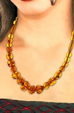 Collana aborigena primitiva africana con pietre ambrate finte rotonde