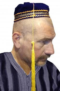 Cappello fez arabo blu da mercante con lungo pennacchio giallo